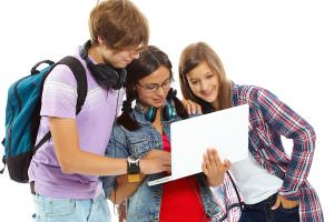 Three teenagers studying with laptop